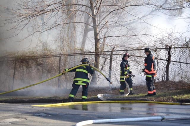 Firefighters battled a fire at Frog Pond Lane and East Main Street in Stratford Sunday at the former Raybestos site. It was first reported as a brush fire, but two buildings were destroyed by the blaze.