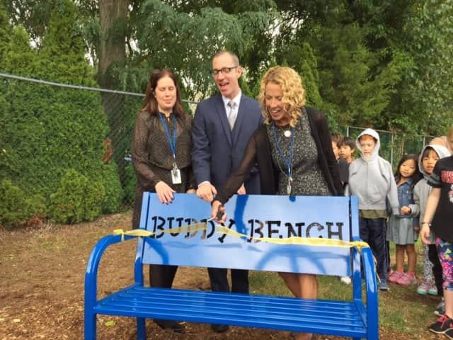 Mrs. Alberti, Principal DeLaura and Superintendent Gross at Norwood School's Buddy Bench ribbon cutting.