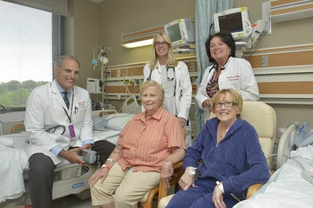 New friends with something in common, Corinne Gammino (seated left) and Kathleen Shafer bonded when both received new hearts.  Here they're seen with (from left) Alan L. Gass, M.D. and nurse practitioners Maureen Raffa, R.N. and Kathy Brown, R.N.