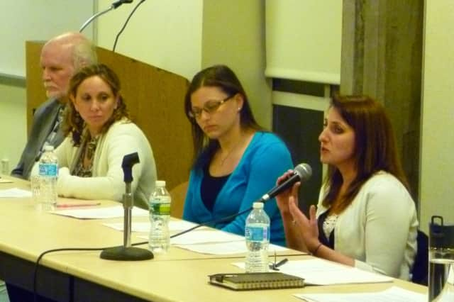 A panel of guidance counselors from the Greenwich school district answers questions from a crowd of parents at a youth mental health panel discussion on Wednesday.